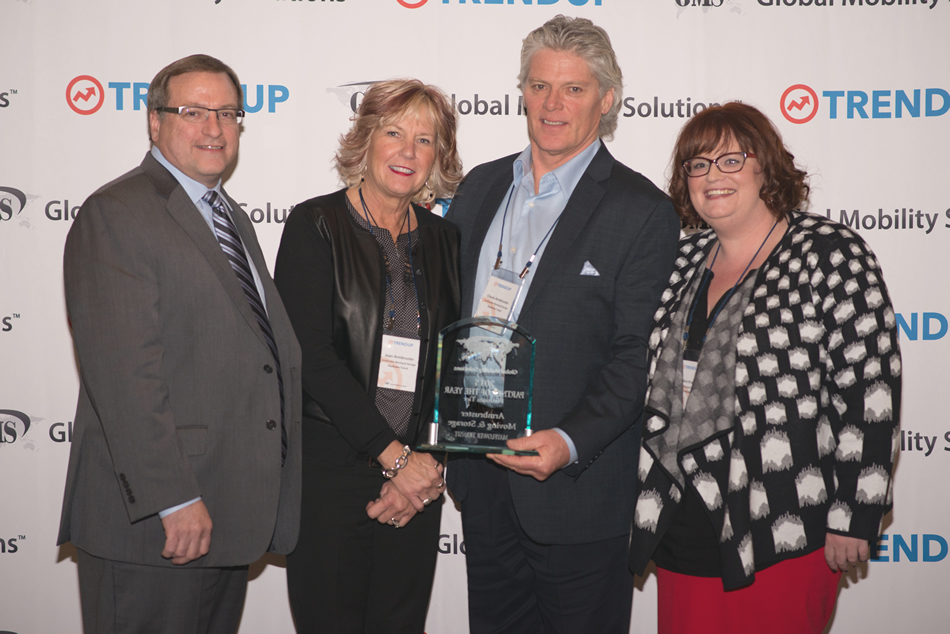 GMS President Steven Wester (left) and GMS Transportation Director Ann Knapp (right) Award Armbruster Moving and Storage (center) with Platinum Partner of the Year Award