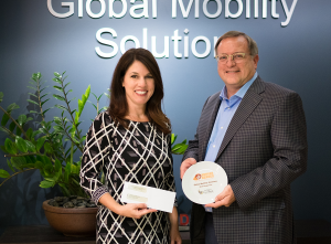 Lisa Notaro of St. Mary's Food Bank presents the Hunger Hero award to Steven Wester, President of Global Mobility Solutions.