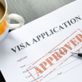 Visa Application Paperwork showing Approved stamp for H-1B visa lottery