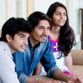 Three young Indian businesspeople working together and having fun while doing it, India e-Services Online Portal Launched by Bureau of Immigration, Government of India