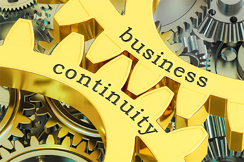 Yellow gears interlocking with the words business continuity plan