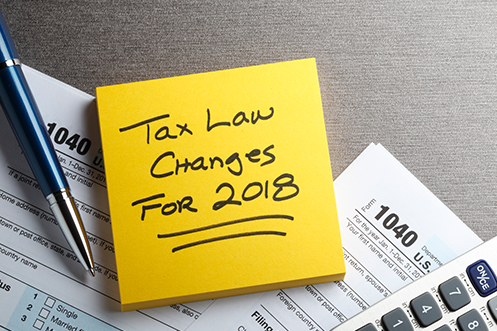 Yellow Sticky Note with Tax Law Changes for 2018 reminding homeowners of home tax deductions