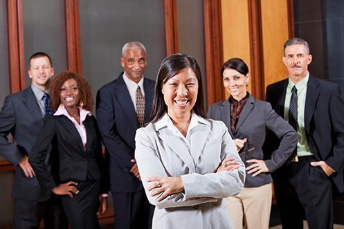 Three male and three female business people, all dressed nicely, smiling, facing front, all are job seekers
