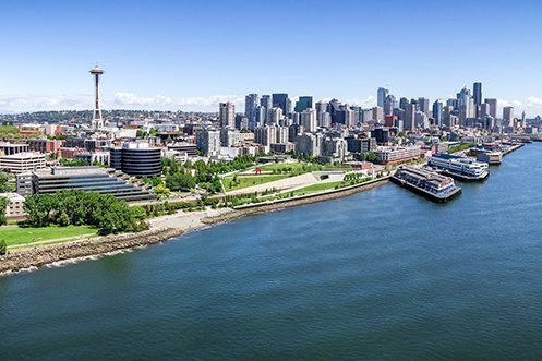 2019 Best States Overall names Washington as the number one state, Seattle port and skyline with blue sky