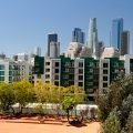 Beautiful apartments in front of the city skyline for Los Angeles