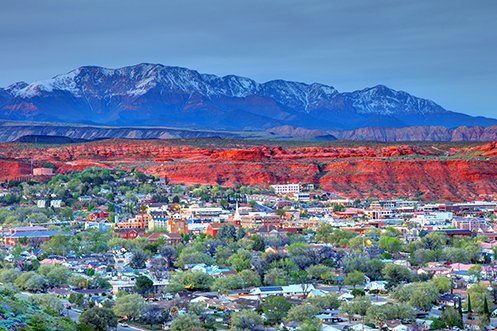 Some U.S. cities add jobs at the highest rates, and the St. George Utah city skyline and surrounding canyons is at the top of one of these lists