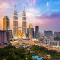 Kuala Lumpur city skyline with growth reflecting Asia relocation trends