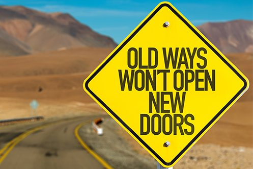 yellow sign saying old ways won't open new doors, showing how business faux pas can be avoided by trying new ways to grow globally