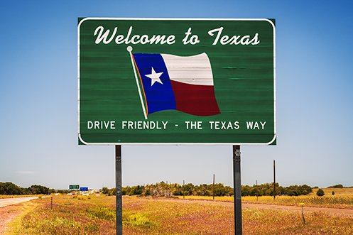 Welcome to Texas sign on roadside at state border to greet those who are moving to the state for a Texas relocation