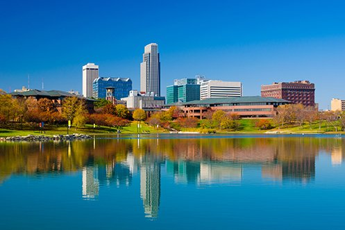 Omaha Nebraska city skyline in front of lake, reflects a good experience with state employment differences