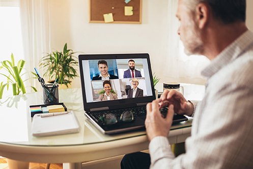 Two male and two female Relocation Management Company representatives presenting their proposal by video to a male Human Resource Professional who hopes to gain expedited bidding benefits