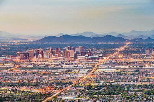 Phoenix Arizona city skyline at dusk, showing a beautiful city destination for companies considering a 2020 Phoenix Relocation